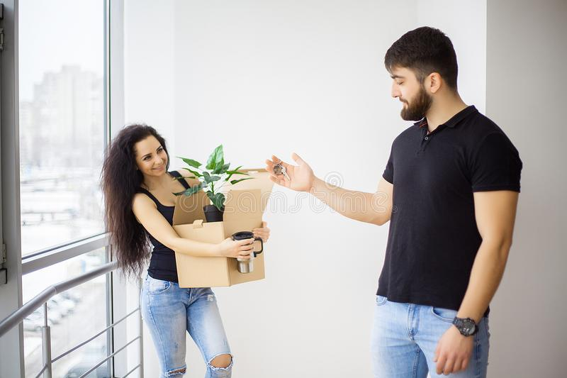 Smiling couple unpack boxes in new home. royalty free stock photography