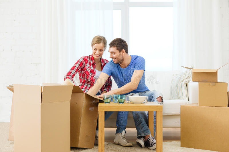 Download Smiling Couple Unpacking Kitchenware Stock Photo - Image: 40042362