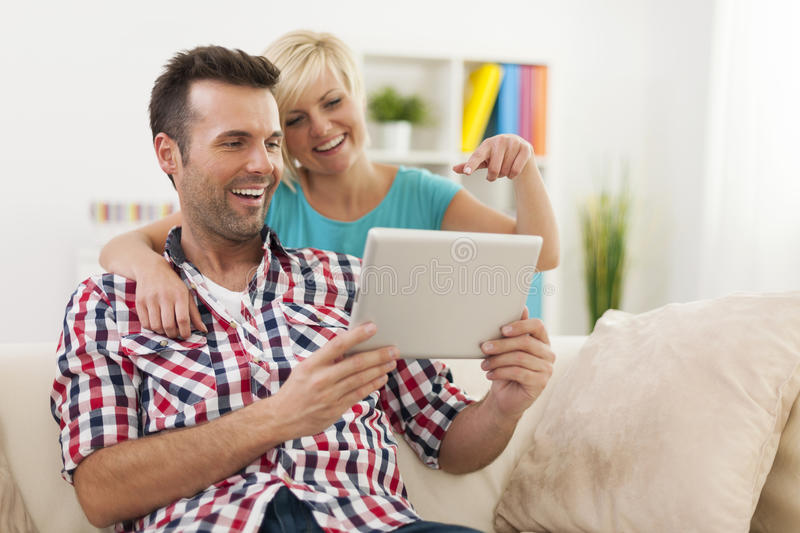 Smiling Couple Using Tablet Stock Photos
