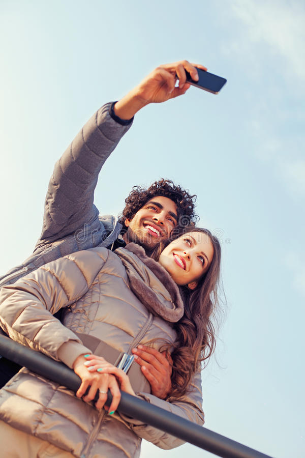 Smiling Couple will making a selfie embraced. With love royalty free stock images