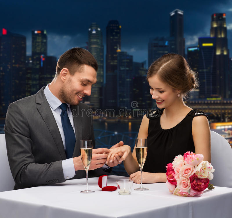 Free Smiling Couple With Wedding Ring At Restaurant Stock Photos - 50942483