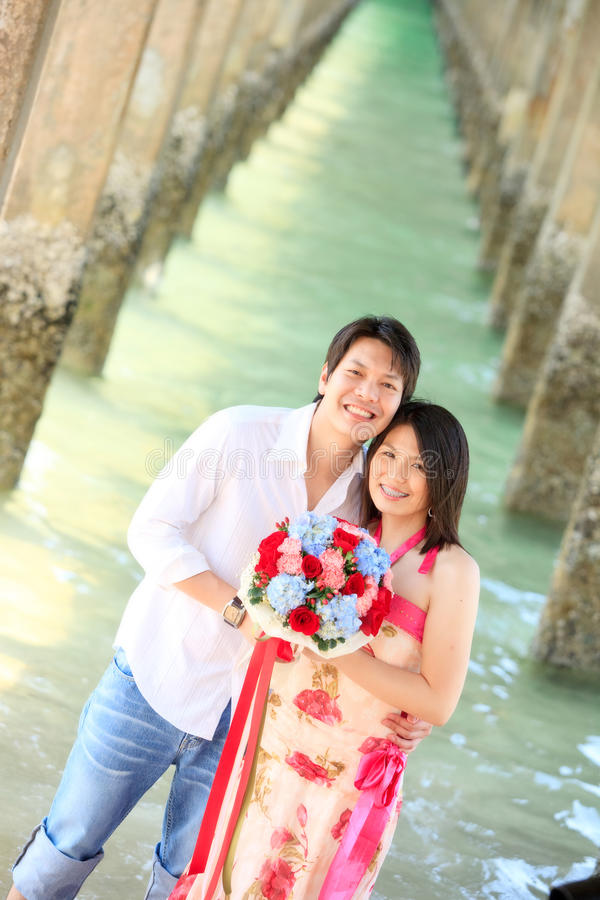 Smiling couples beach stock image