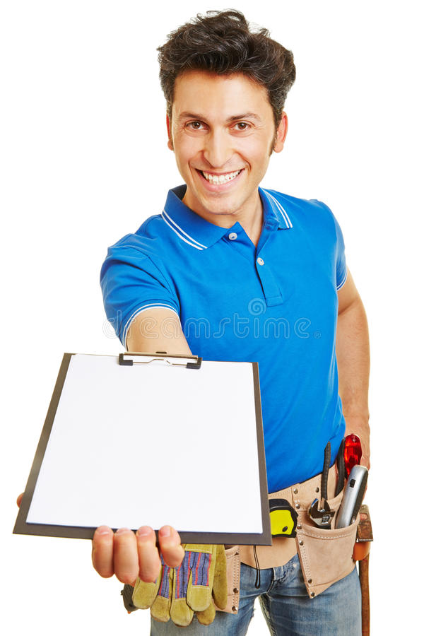 Smiling craftsman holding clipboard royalty free stock photos
