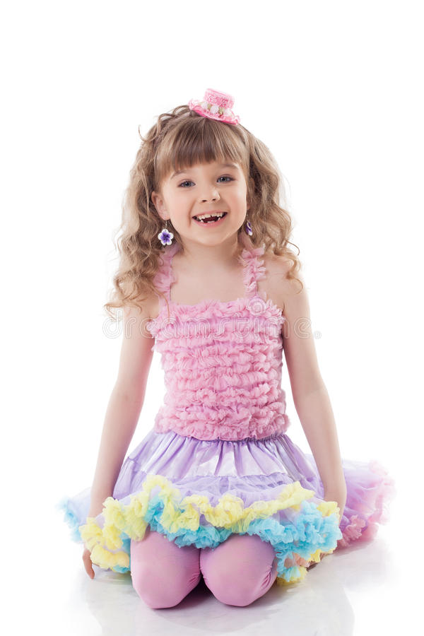 Smiling curly girl posing in candy costume stock photo
