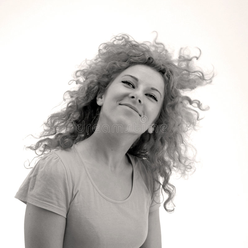 Smiling curly-haired girl stock photo