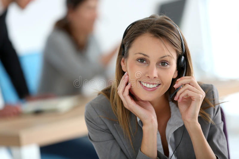 Smiling customer service assistant working stock photo