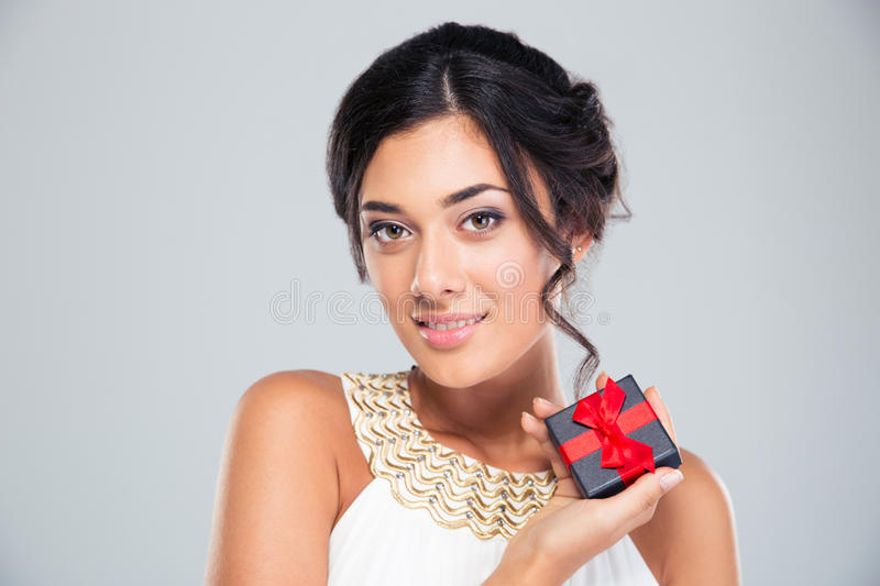 Smiling cute girl holding jewelry gift box royalty free stock photography