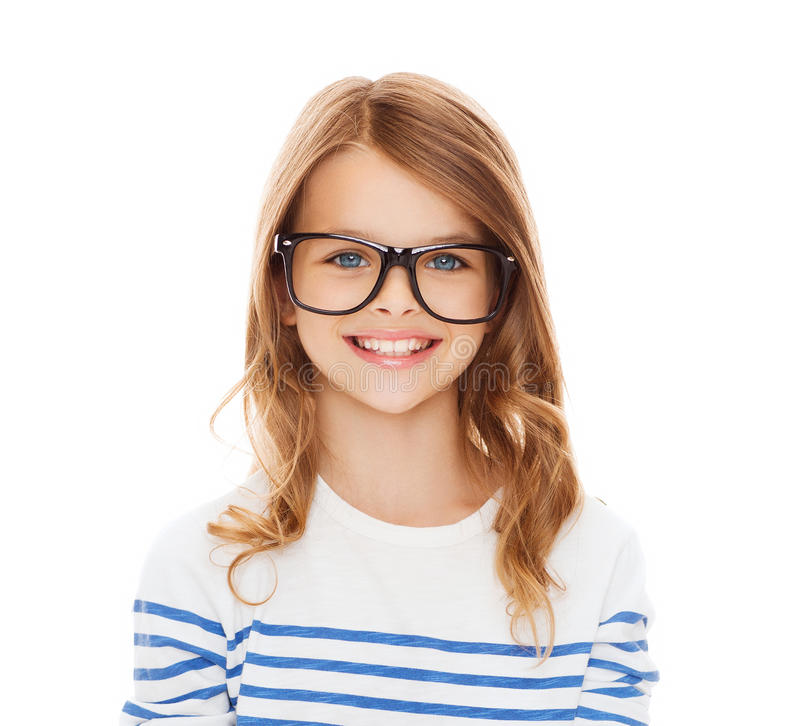 Smiling cute little girl with black eyeglasses stock image