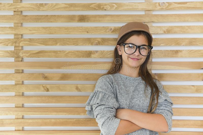 Smiling cute little girl with black eyeglasses over white background stock image