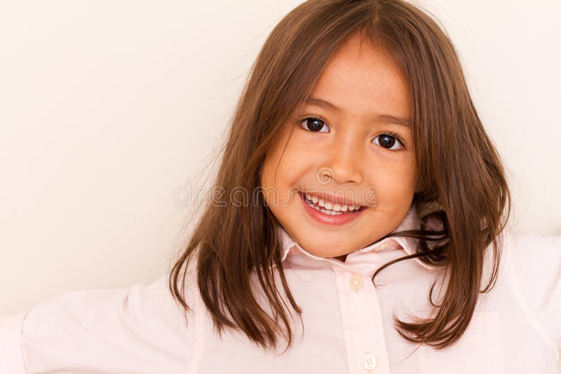 Smiling cute little girl stock images