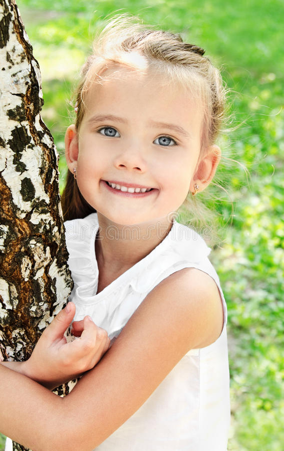 Download Smiling Cute Little Girl Near The Birch Stock Image - Image: 33208359