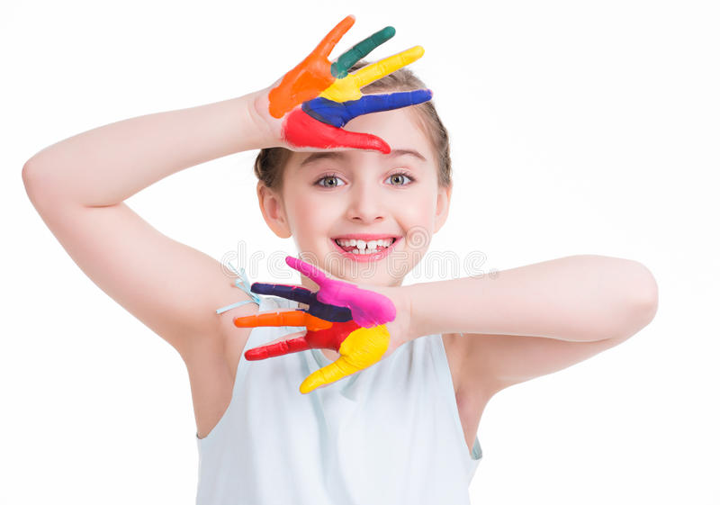 Smiling cute little girl with painted hands. royalty free stock photography
