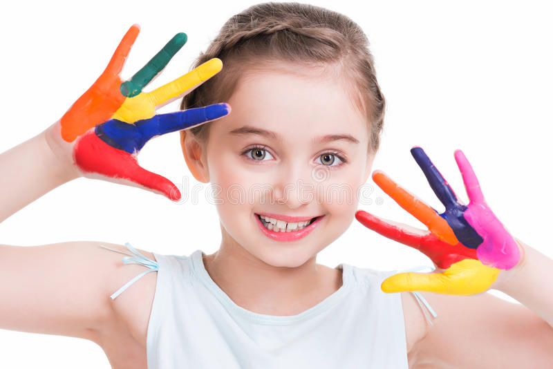 Smiling cute little girl with painted hands. stock image
