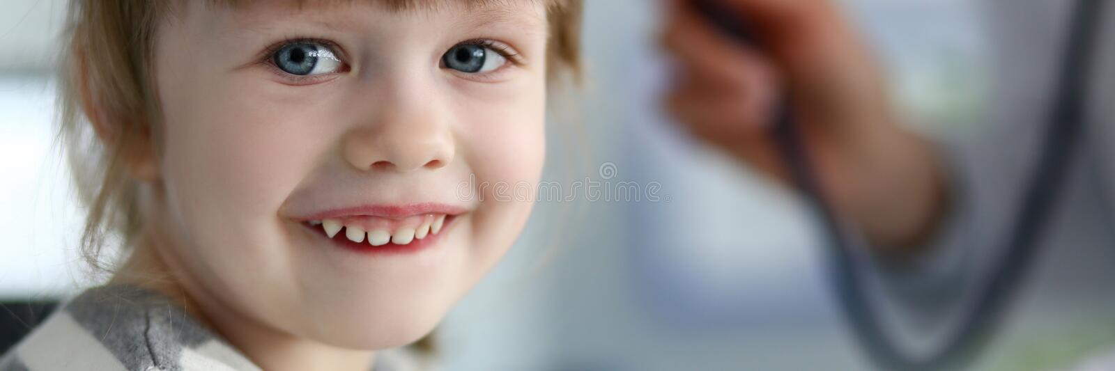 Smiling cute little patient interacting with female doctor royalty free stock photos