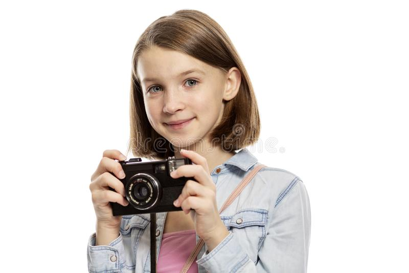 Smiling cute teen girl with a camera, close-up, isolated on white background stock photo