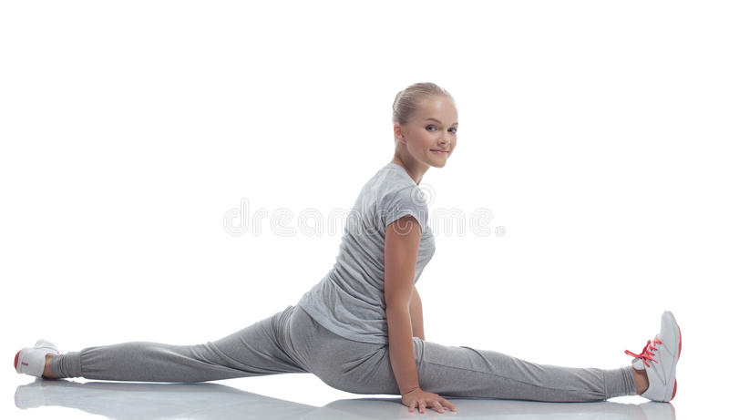 Download Smiling Cute Teenage Girl Doing Stretching Stock Image - Image: 32381587