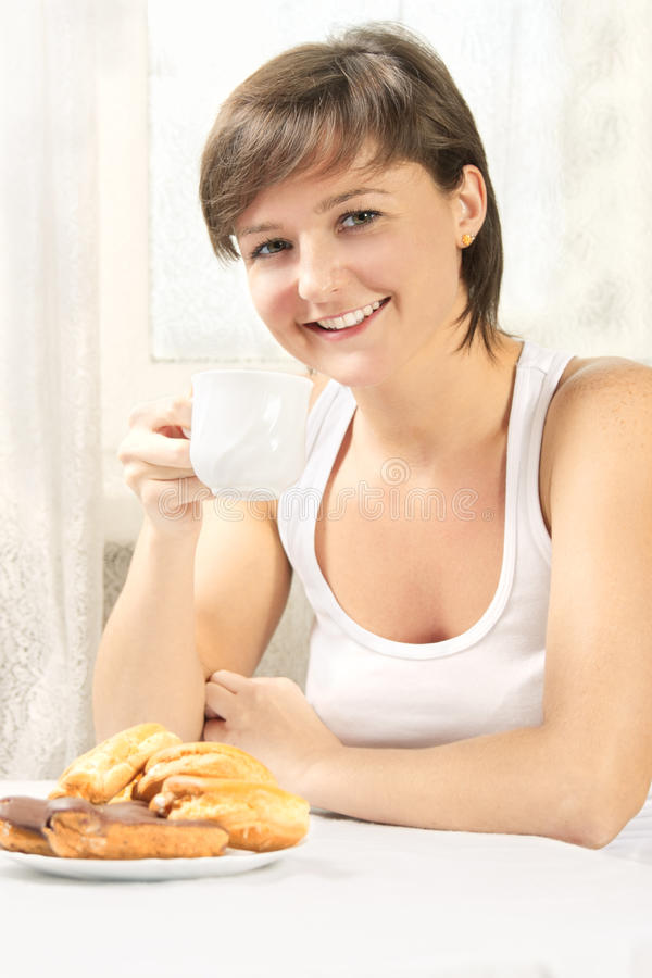 Download Smiling Cute Woman Drinking Tea With Cakes Stock Image - Image: 15756599