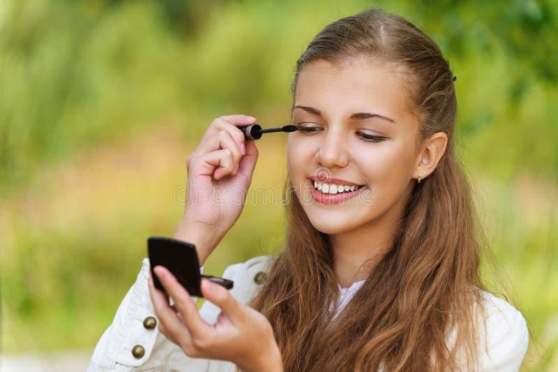 Download Smiling Cute Woman Paints Eyelashes Stock Image - Image: 26980517