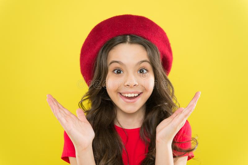 Smiling cutie. Small child with cheerful smiling face on yellow background. Little girl happy smiling with beauty look. Adorable beauty model with cute smile stock image