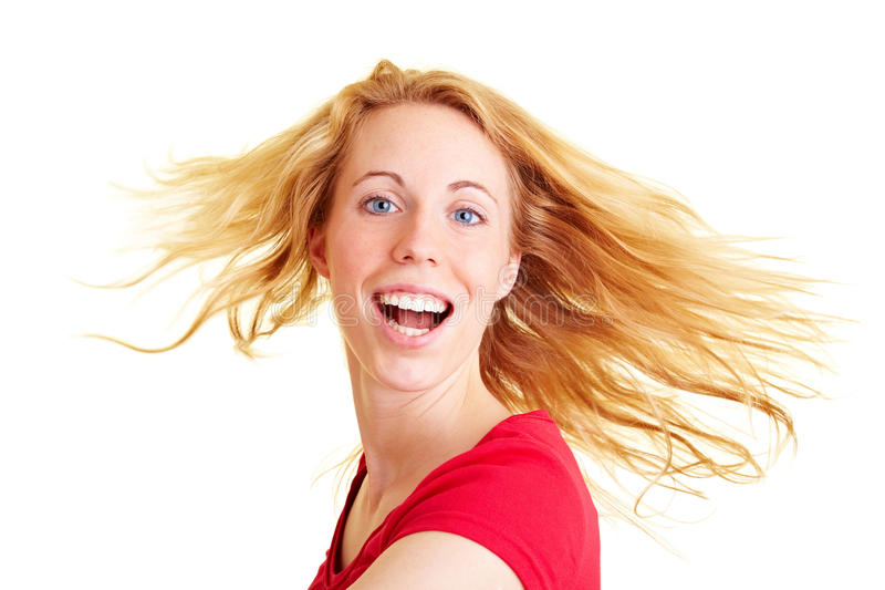 Smiling and dancing. Happy woman with long hair dancing and smiling royalty free stock images