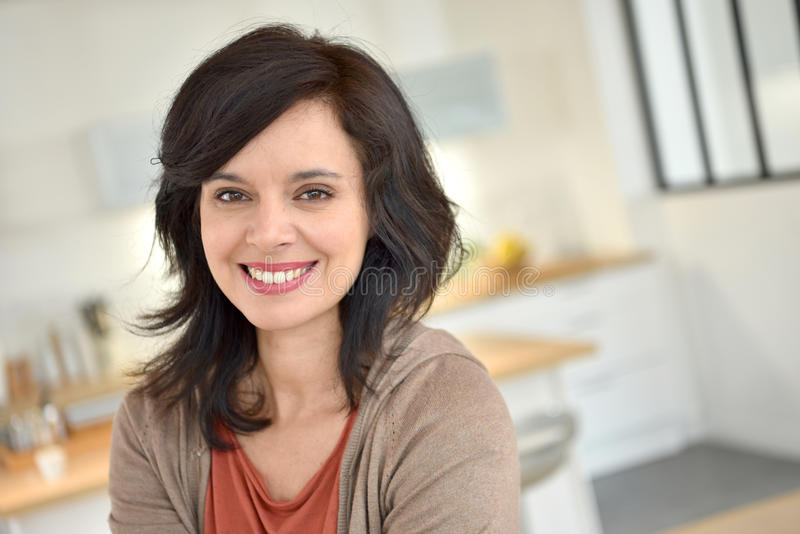 Smiling dark-haired woman royalty free stock photography