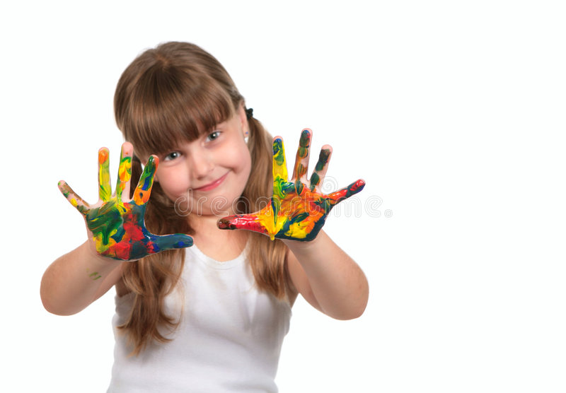 Smiling Day Care Preschool Child Painting With Her. Hands. Only Hands Are in Focus royalty free stock image