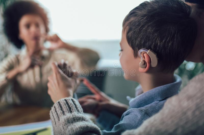 Deaf boy learning sign language. Selective focus stock images