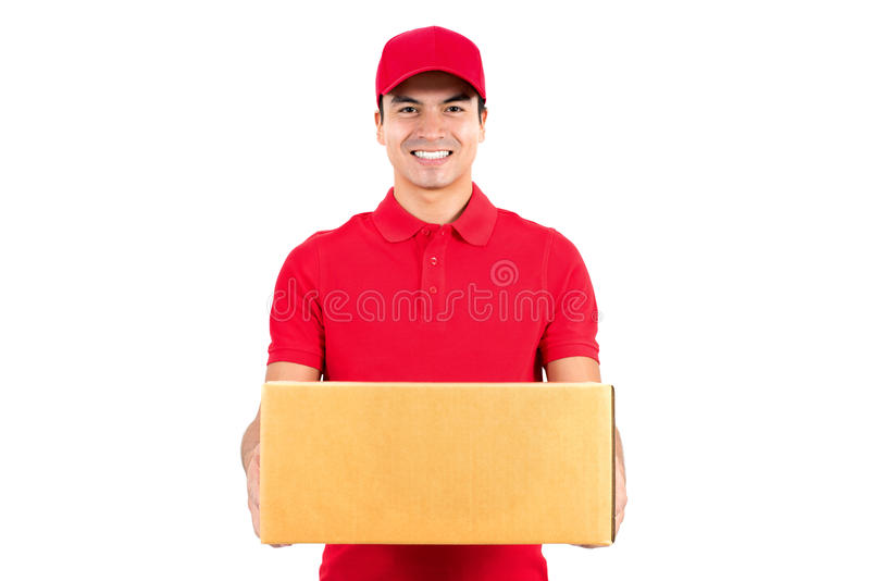 Smiling delivery man carrying a parcel box royalty free stock images
