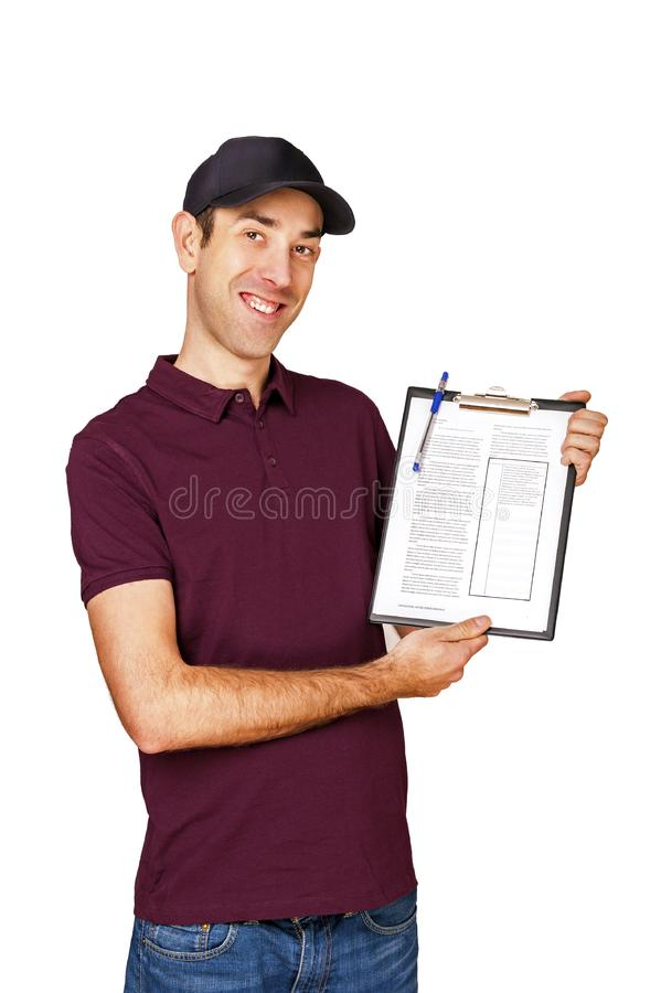 Smiling delivery man holding clipboard on white smiling stock image
