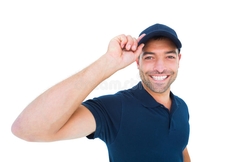 Smiling delivery man wearing cap on white background. Portrait of smiling delivery man wearing cap on white background royalty free stock photo