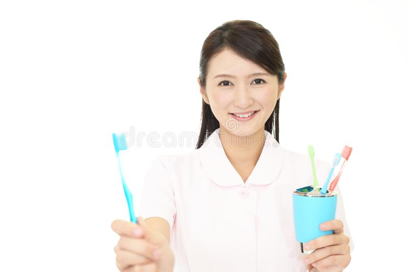 Smiling dental hygienist. Isolated on white background royalty free stock photography
