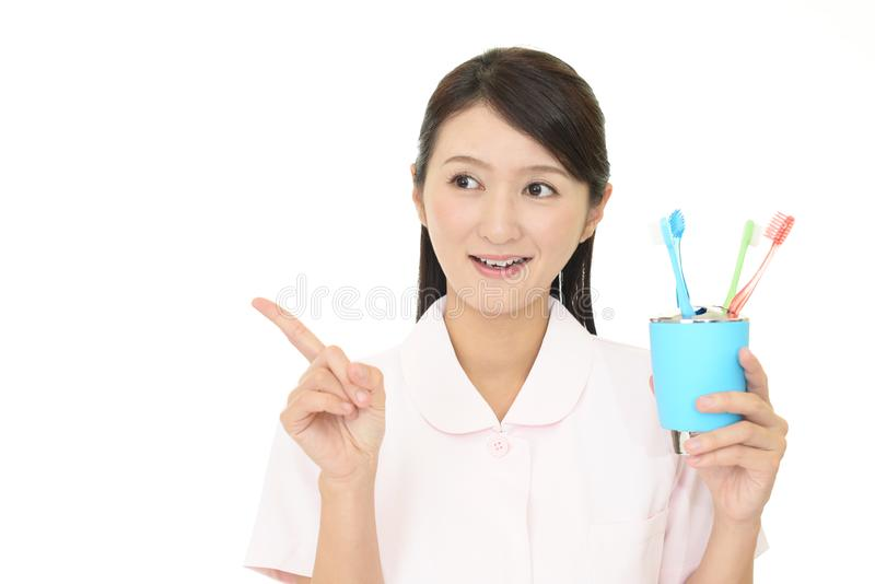 Smiling dental hygienist. Isolated on white background stock photography
