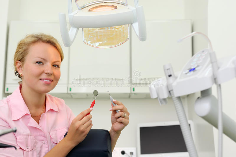 Download Smiling Dentist Sits In Cabinet Of Dental Clinic Stock Photo - Image: 26337768