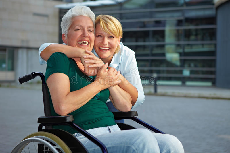 Smiling disabled senior woman stock images