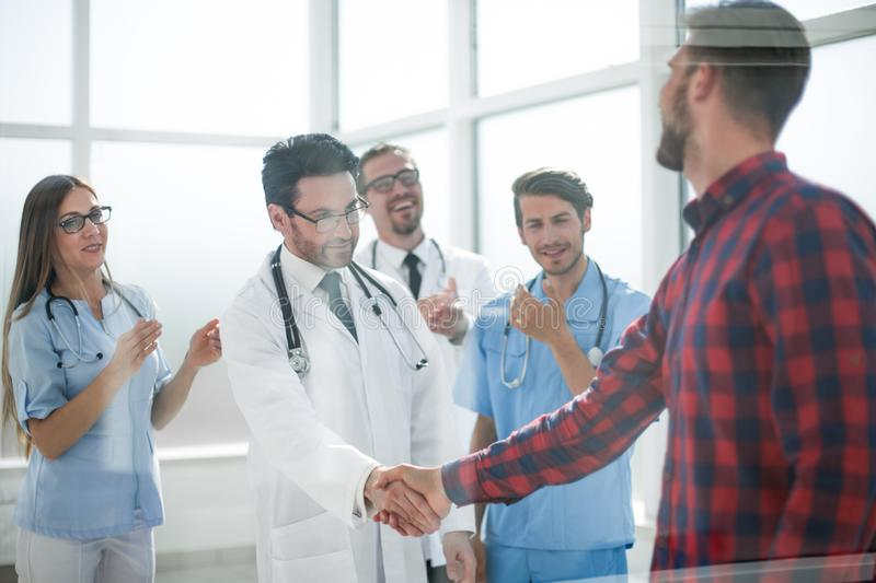 Thankful patient shaking doctors hand stock image