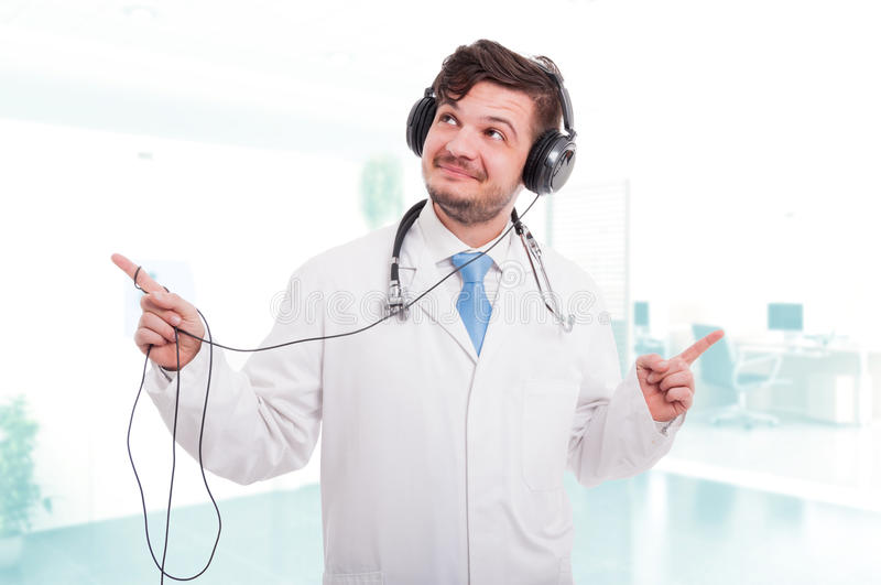 Smiling doctor enjoying the good music stock photo