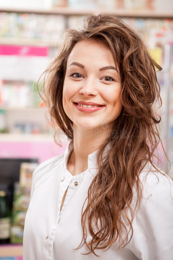 Smiling doctor in front of her desk at work stock photography