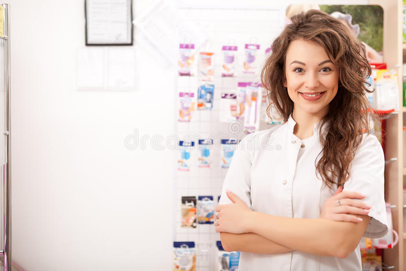 Smiling doctor in front of her desk at work stock photos