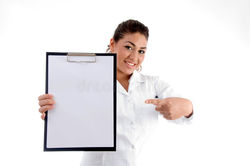 Smiling doctor indicating the writing board royalty free stock photography