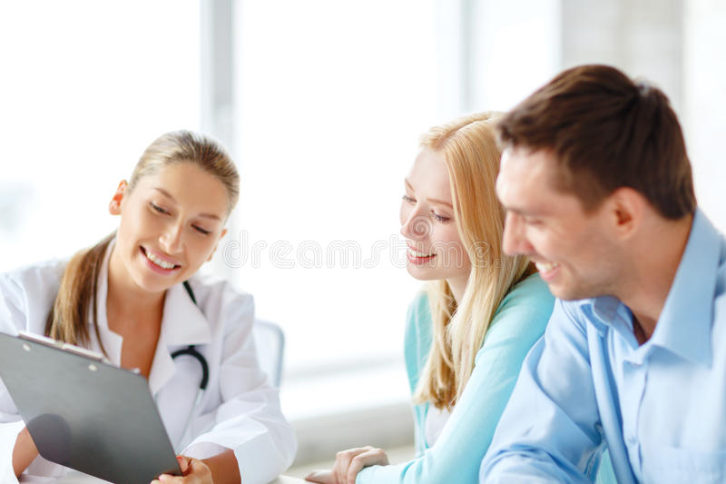 Smiling doctor with patients in hospital stock photos