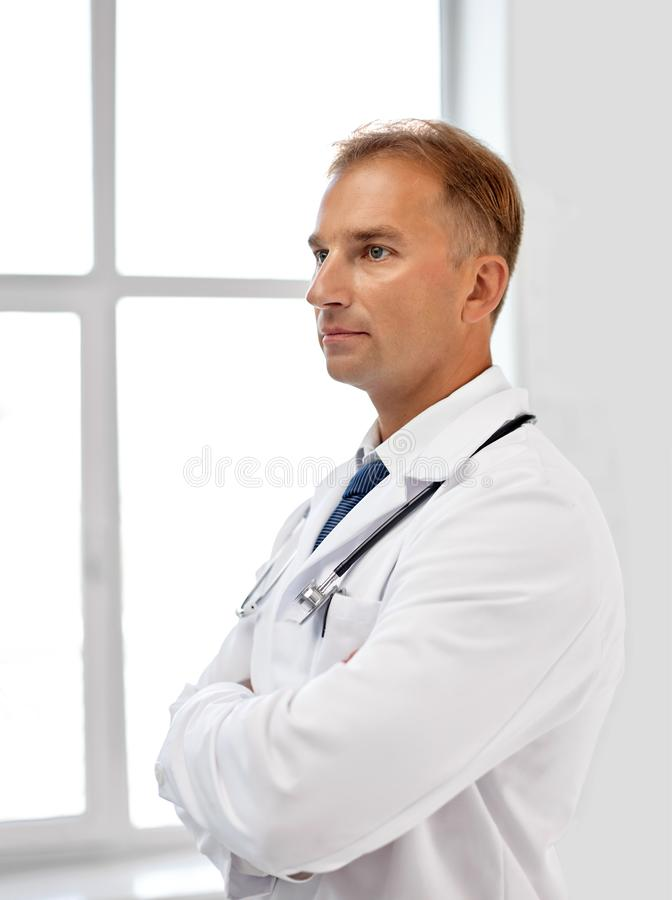 Smiling doctor in white coat at hospital royalty free stock photos