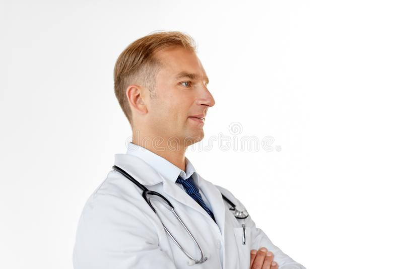 Smiling doctor in white coat at medical office royalty free stock image