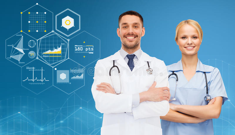 Smiling doctors with stethoscopes over charts royalty free stock image