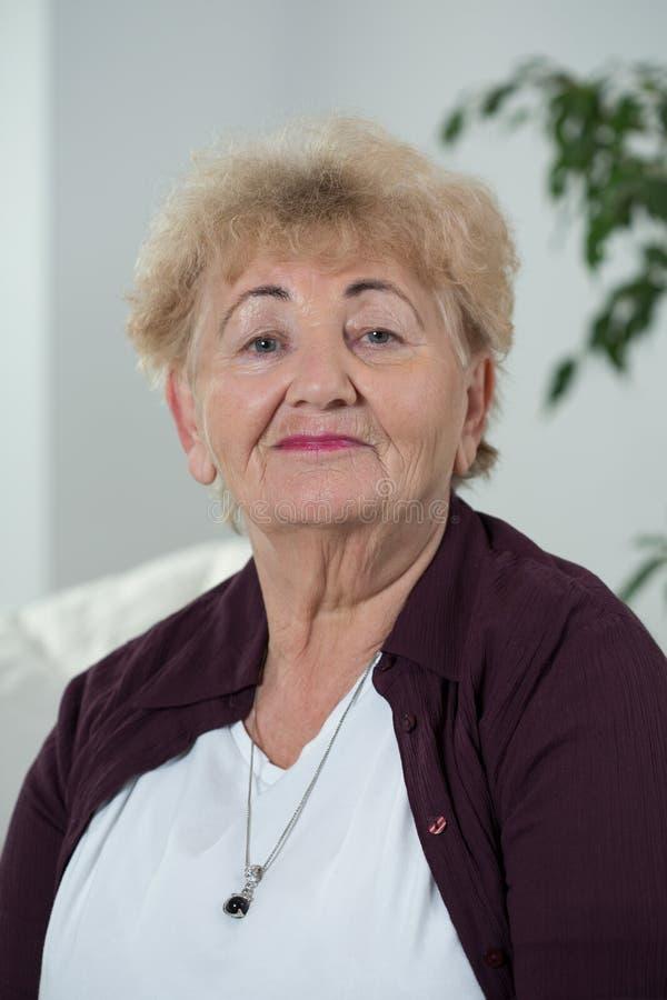 Smiling elder woman stock photo
