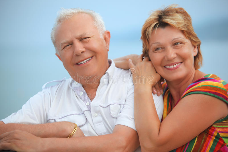 Smiling elderly married couple on veranda stock image