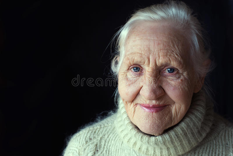 Smiling elderly woman royalty free stock images