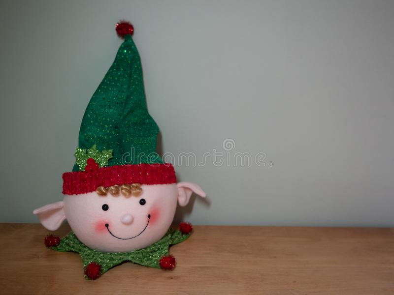 Smiling Elf Decoration with Green Hat and Red Pom Pom royalty free stock image