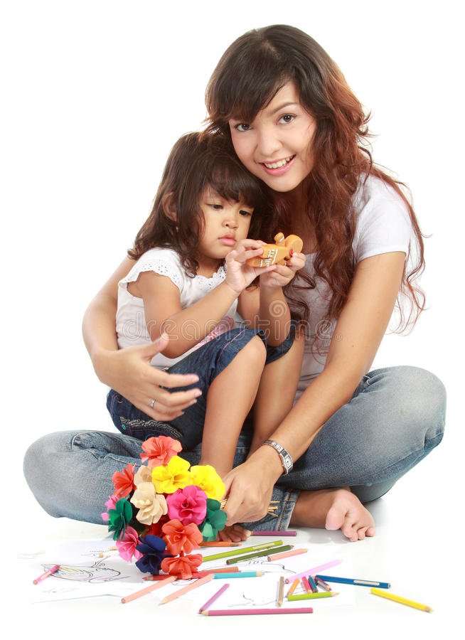 Smiling embracing mom and daughter stock images