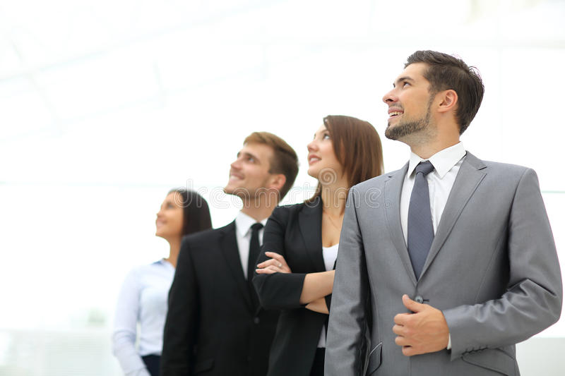 Smiling employee's in a line at work royalty free stock images