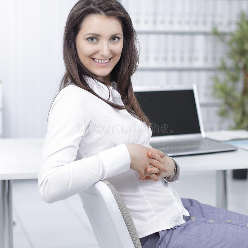 Smiling employee sitting at a Desk in the office. Photo with copy space royalty free stock images